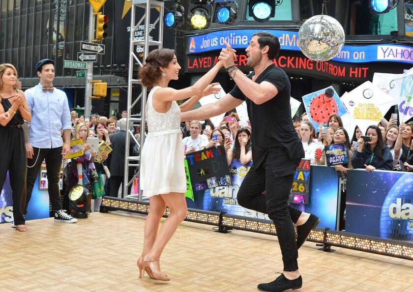 """Dancing With The Stars"" Season 18 winners Meryl Davis and Maksim Chmerkovskiy perform at ABC's ""Good Morning America"" at Times Square."