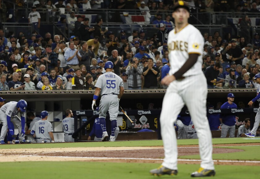 Blake Snell walks to the dugout after striking out Los Angeles Dodgers' Albert Pujols t