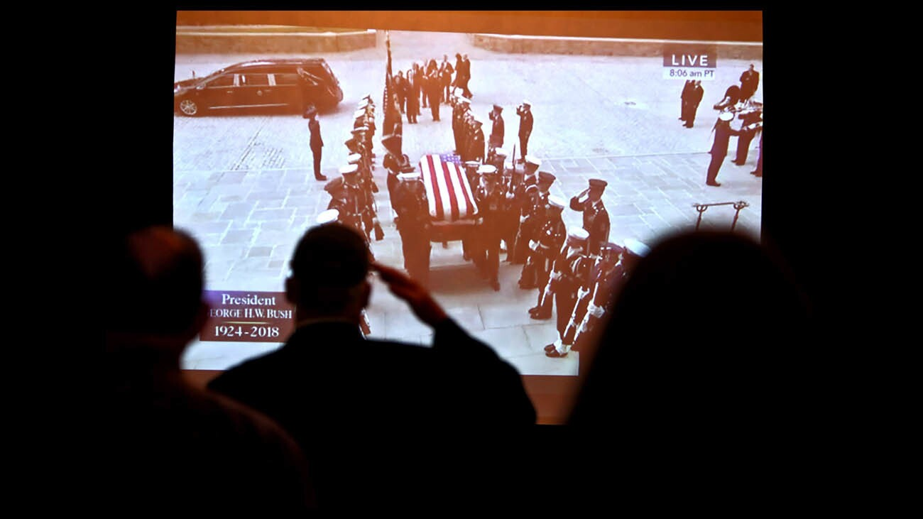 Photo Gallery: Visitors watch broadcast of State Funeral for President George H.W. Bush at Nixon Library