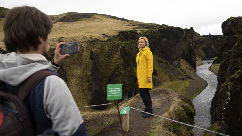 In this photo taken Wednesday, May 1, 2019, Russian tourist Nadia Kazachenok poses for a photograph