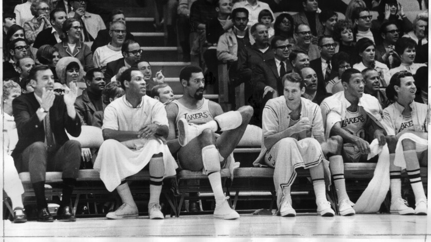 Lakers coach Bill van Breda Kolff, left, applauds during a game against the Golden State Warriors, and why not be happy with a bench like this to call on: from left, Elgin Baylor, Wilt Chamberlain, Jerry West, Bill Hewitt and Keith Erickson.