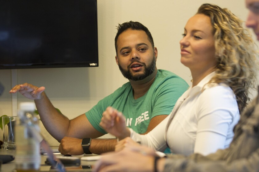 Shiv Shukla and Lian Price during their weekly Monday morning meeting.