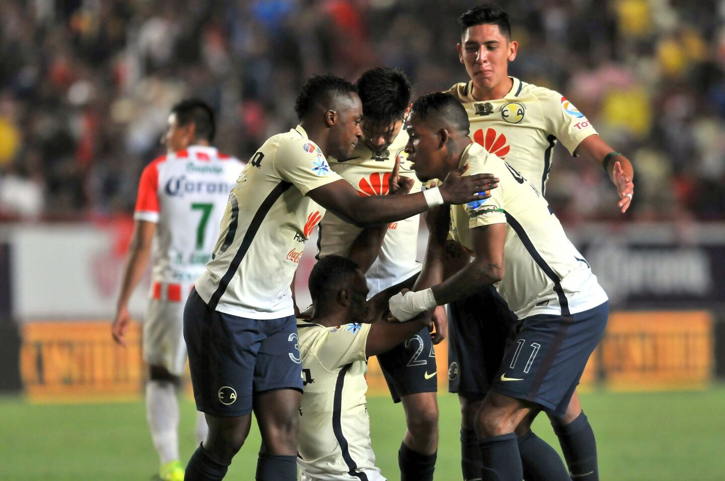 William Da Silva (C Down) of America celebrates his goal with his teammates during the macth against Necaxa during their Mexican Apertura 2016 Tournament first leg semifinal football match at Victoria stadium on December 01, 2016, in Aguascalientes,Mexico. / AFP PHOTO / VICTOR CRUZVICTOR CRUZ/AFP/Getty Images ** OUTS - ELSENT, FPG, CM - OUTS * NM, PH, VA if sourced by CT, LA or MoD **
