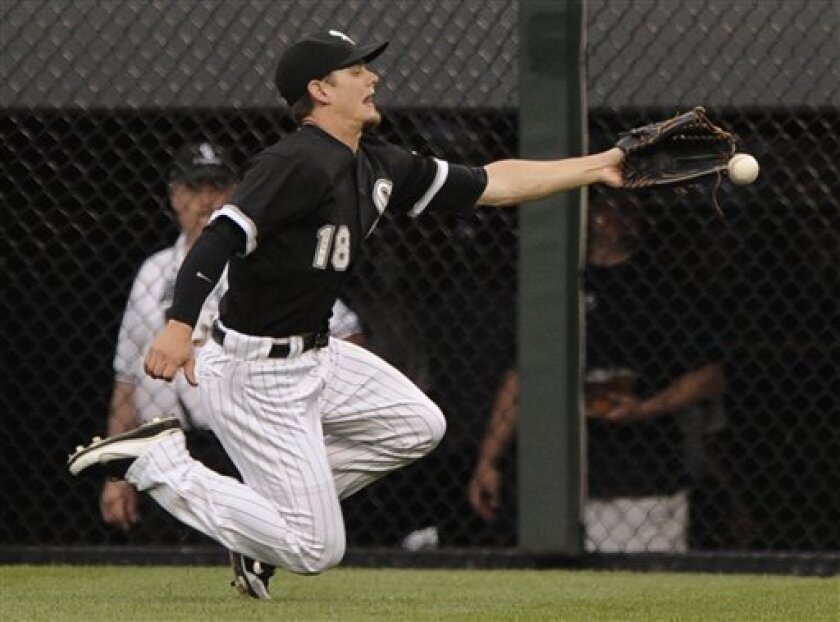 Chicago White Sox center fielder Brent Lillibridge misses a fly ball that went for a triple by Kansas City Royals' Alcides Escobar during the second inning of a baseball game in Chicago, Tuesday, July 5, 2011. (AP Photo/ Paul Beaty)