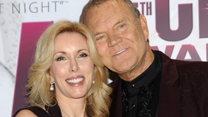 Singer Glen Campbell and his wife, Kim, at the CMA Awards in late 2011, several months after his Alzheimer's diagnosis was revealed.