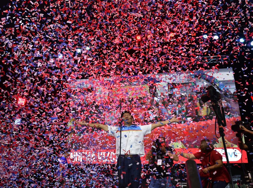 Vice-presidential candidate and son of the late dictator Ferdinand, Marcos Ferdinand Marcos Jr., reacts as confetti rains during a campaign event in Manila on May 5, 2016.