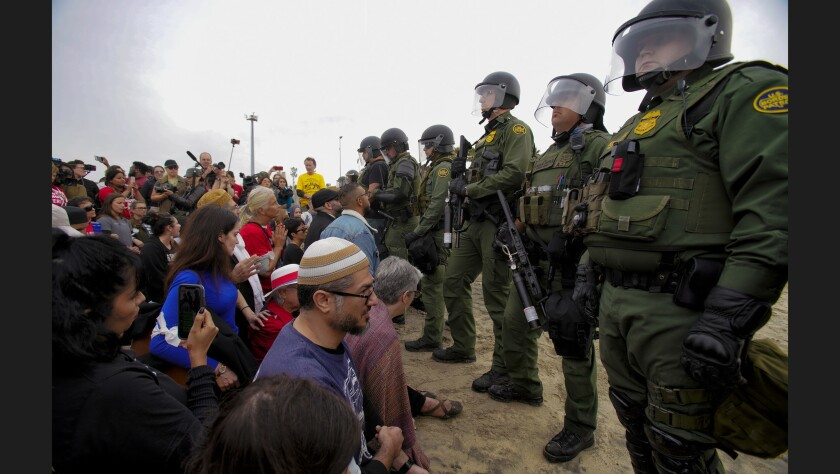 At Border Field State Park on Monday, more than 300 faith and community leaders took part in a protest against the treatment of the migrants in Tijuana, Mexico.