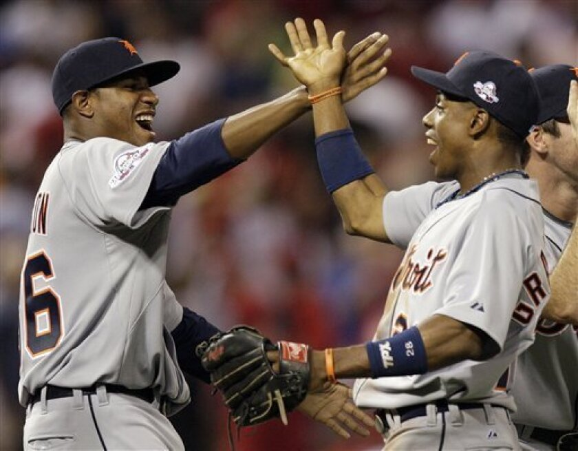 American League's Curtis Granderson, right, of the Detroit Tigers is congratulated by teammate Edwin Jackson after defeating the National League 4-3 in the MLB All-Star baseball game in St. Louis, Tuesday, July 14, 2009. (AP Photo/Jeff Roberson)