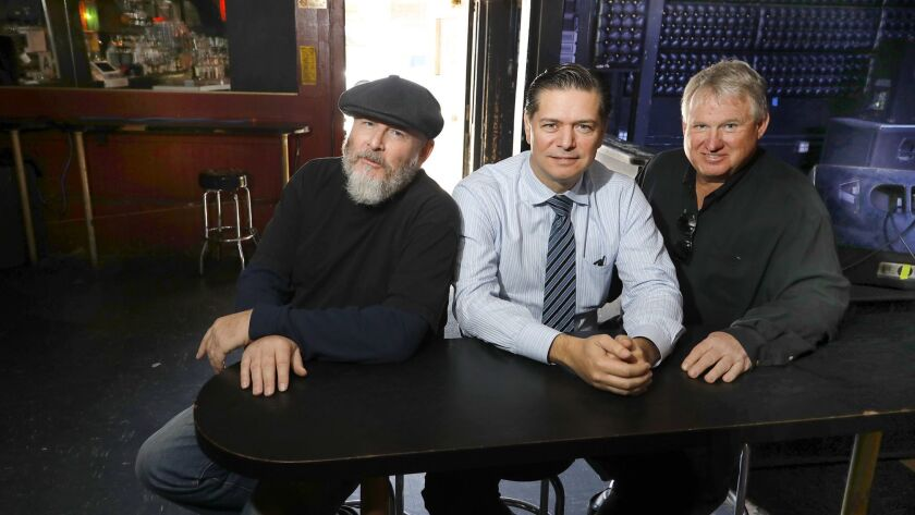 Local radio programmer Michael Halloran, left, Grupo Cadena president Mario Mayans and Flip Media owner Randal Phillips gathered at the Casbah night club to discuss 98.9 MORE-FM's new bilingual format mixing rock en Espanol with alternative rock.