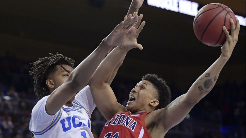 Arizona forward Ira Lee, right, shoots as UCLA center Moses Brown defends during the first half on Saturday at Pauley Pavilion.