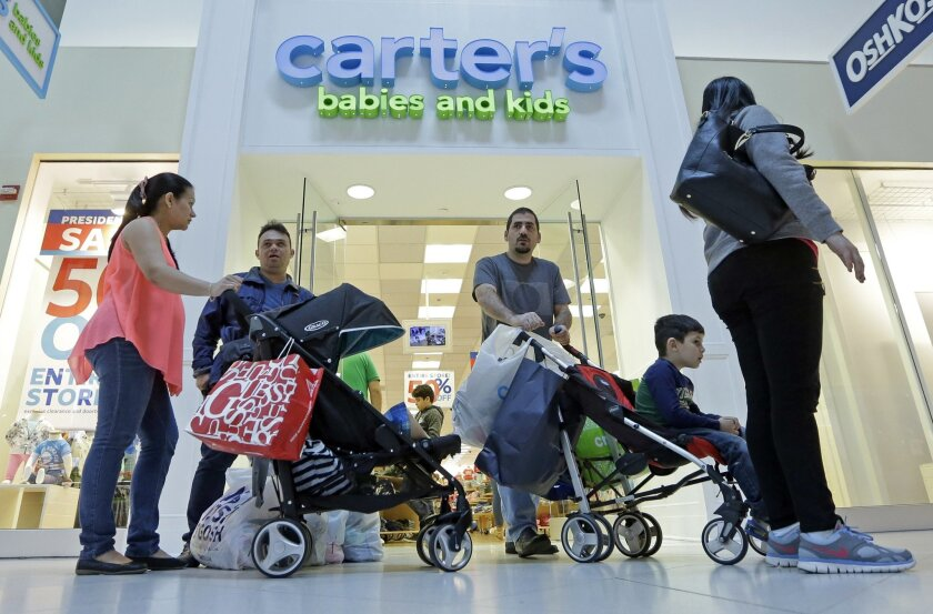 In this Tuesday, Feb. 9, 2016, photo, shoppers are shown in Miami. On Friday, Feb. 12, 2016, the Commerce Department releases retail sales data for January. (AP Photo/Alan Diaz)