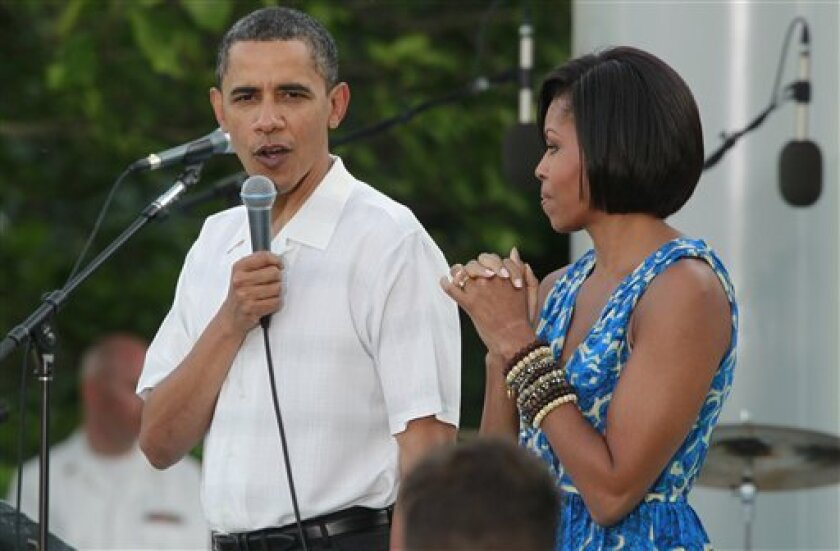 President Barack Obama speaks as he and first lady Michelle Obama host the Congressional Picnic on the South Lawn of the White House in Washington, Tuesday, June 8, 2010. (AP Photo/Charles Dharapak)