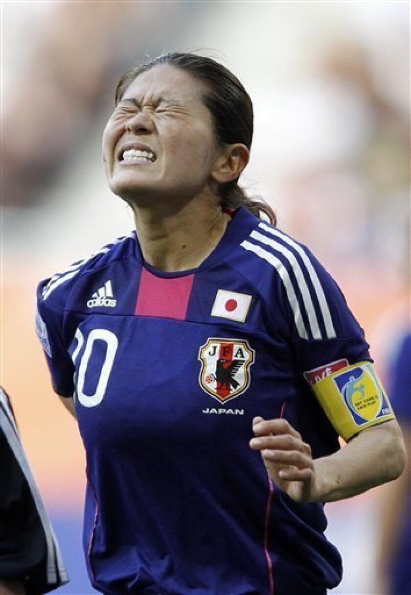 Japan's Homare Sawa grimaces during the group B match between England and Japan at the Women's Soccer World Cup in Augsburg, Germany, Tuesday, July 5, 2011. (AP Photo/Matthias Schrader)