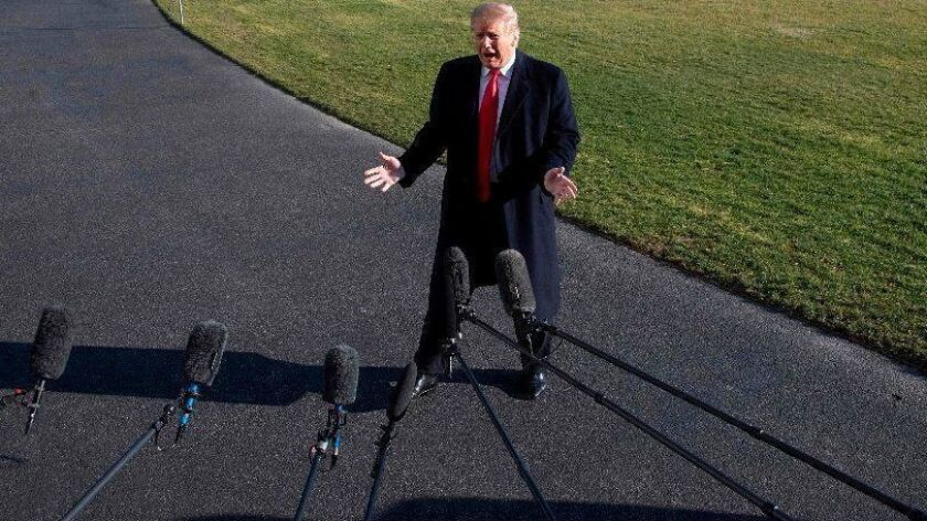 President Trump speaks to members of the media outside the White House on Jan. 6.