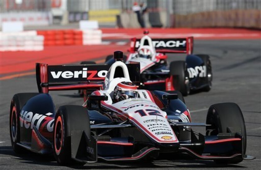 IndyCar driver Will Power, of Australia, steers his car during a practice session in Sao Paulo, Brazil, Saturday, May 4, 2013. Brazil will host the 4th race of the IndyCar season on May 5. (AP Photo/Andre Penner)