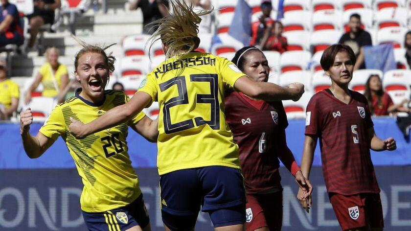 Sweden's Mimmi Larsson, left, and Sweden's scorer Elin Rubensson celebrate their side's fifth goal d
