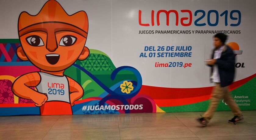 A man walks by a big poster depicting Milco -the official mascot of the Lima 2019 Pan-American Games- in Lima, on July 22, 2019. - The 2019 Pan American Games will take place from July 26 to August 11. (Photo by Luis ROBAYO / AFP)LUIS ROBAYO/AFP/Getty Images ** OUTS - ELSENT, FPG, CM - OUTS * NM, PH, VA if sourced by CT, LA or MoD **