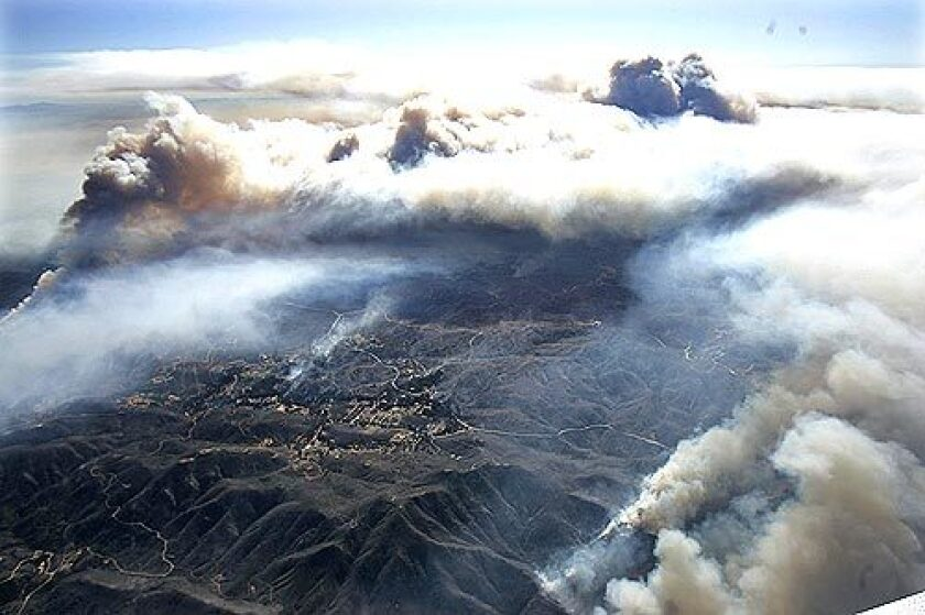 Aerial view: The Esperanza fire sends plumes of smoke high into the air near Banning.