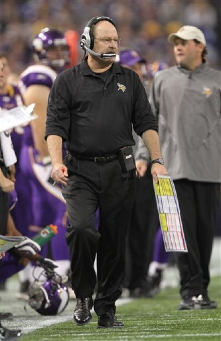 Minnesota Vikings coach Brad Childress walks the sideline in the second quarter of an NFL football game against the Arizona Cardinals in Minneapolis on Sunday, Nov. 7, 2010. (AP Photo/Andy King)