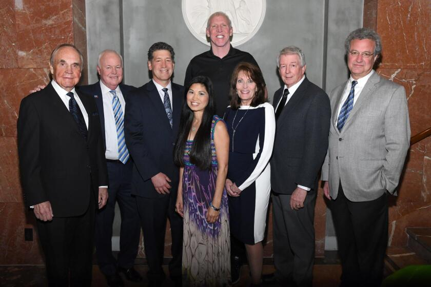 Dick Enberg (emcee), Tom Turner (NCRC board chair), Steve Dinken (NCRC president), Lori and Bill Walton (honorees), Sandy and Darrell Scott (founders; Rachel's Challenge [honoree]), Richard Cohen (president, Southern Poverty Law Center [honoree])