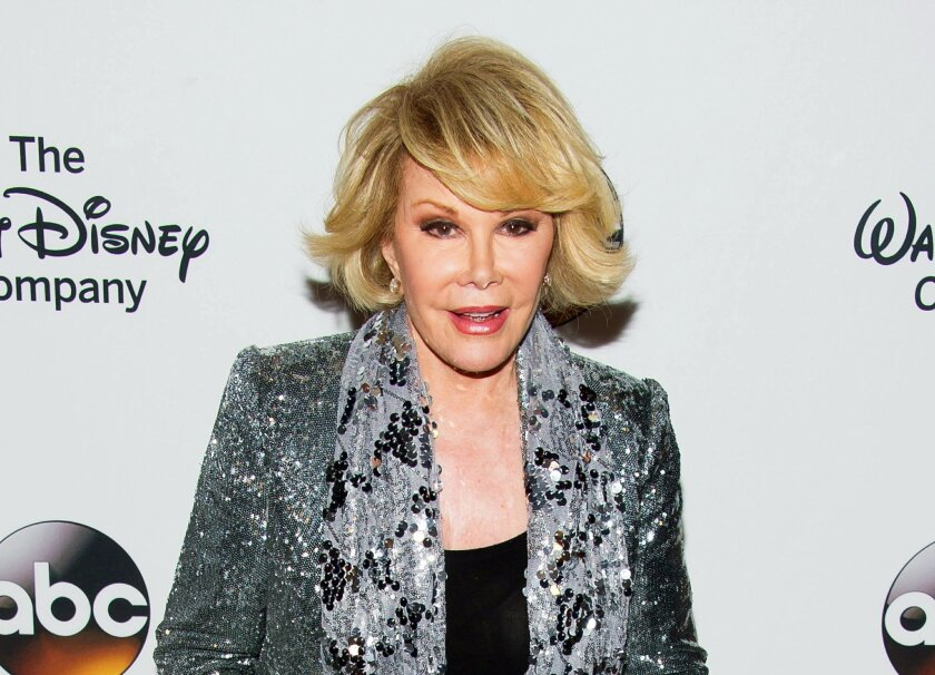 FILE - In this May 14, 2014 file photo, TV personality Joan Rivers attends A Celebration of Barbara Walters in New York. The New York state health department is investigating the circumstances surrounding Joan Rivers' cardiac arrest during an outpatient procedure. Rivers was hospitalized Aug. 28, a