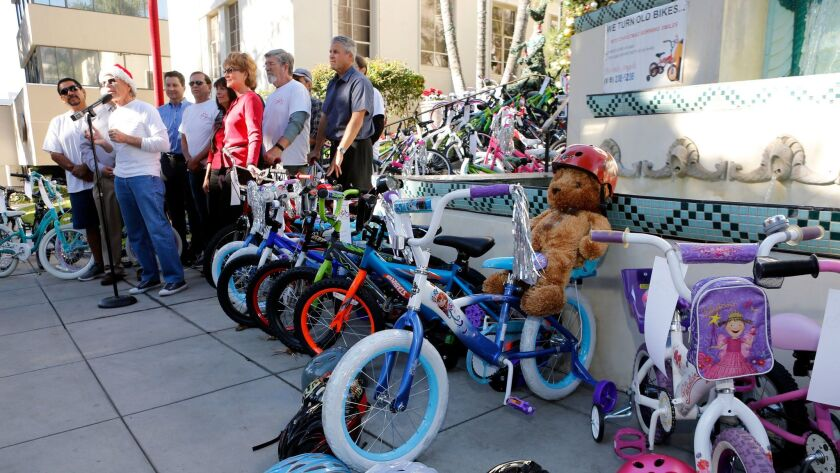 Dozens of bikes were displayed during annual Burbank Bike Angels press conference, in front of City Hall in Burbank on Wednesday, Dec. 13, 2017. Bike Angels collects used bikes throughout the year and restores them to give away to needy children during Christmas.
