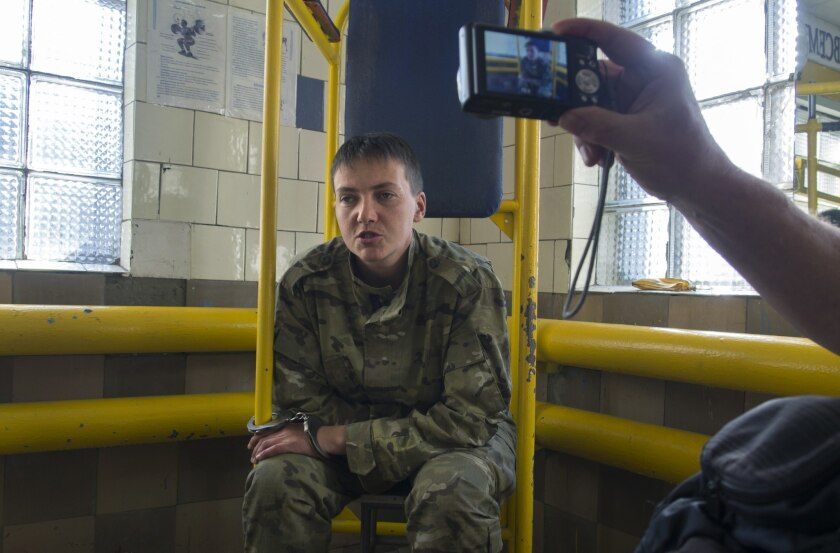 Ukrainian military pilot Nadezhda Savchenko is shown in the custody of pro-Russia militants on June 19.