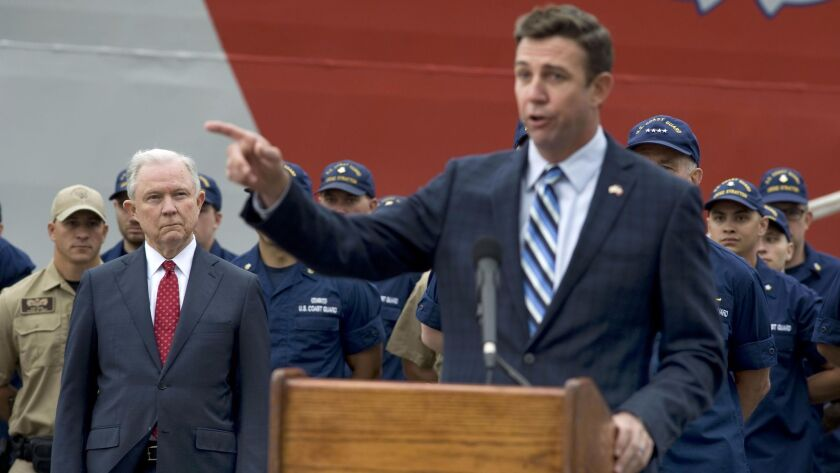 Rep. Duncan Hunter, at podium, is under investigation by the U.S. Department of Justice, which is headed by Attorny General Jeff Sessions, in red tie. Both appeared at an event in San Diego last month.