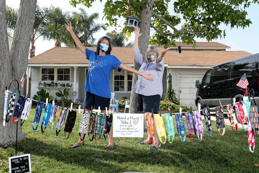 Newport Beach residents Nita Livingston, 69, left, and Nancy Buck, 75,