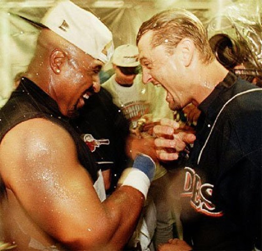 OCT. 14, 1998: Greg Vaughn and Trevor Hoffman celebrated after the Padres won the pennant. (John Gastaldo / U-T file)