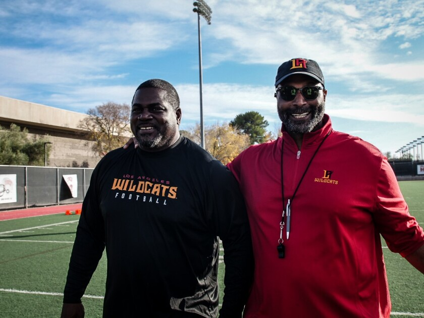 L.A. Wildcats defensive coordinator Pepper Johnson, left, and general manager Winston Moss.