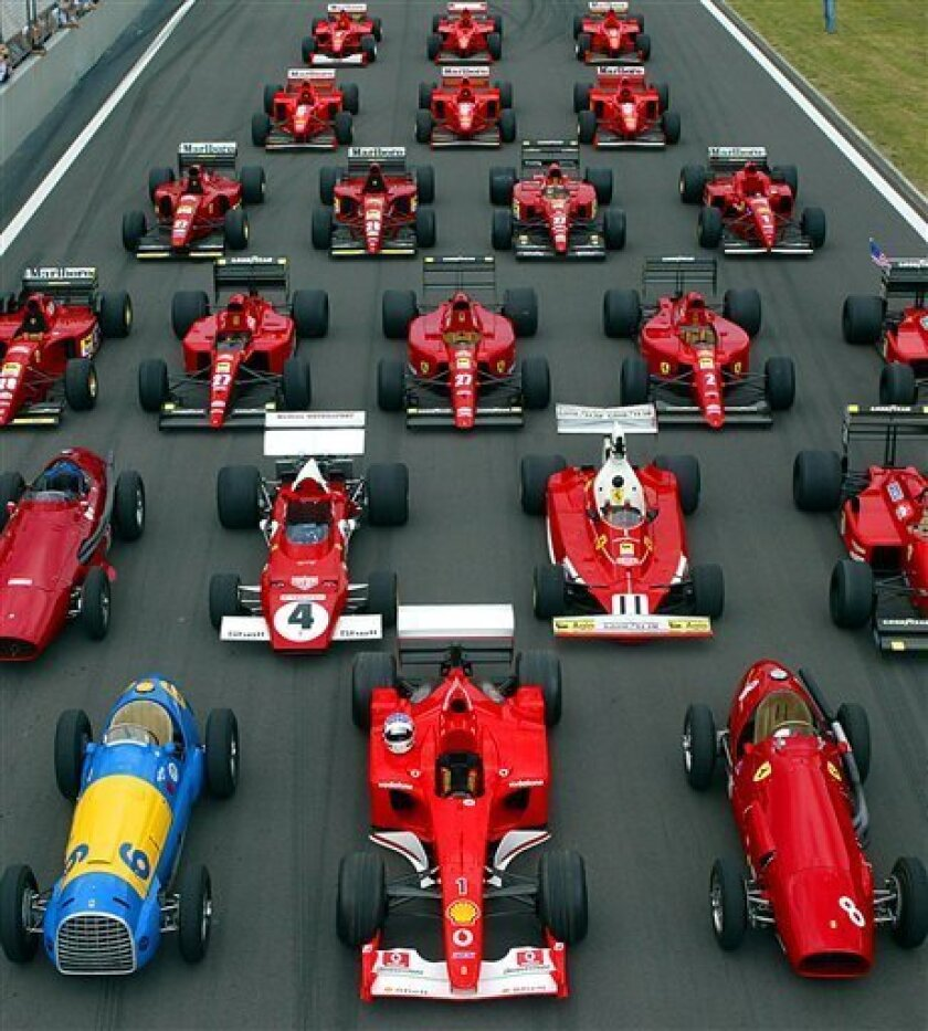 """FILE - In this Wednesday July 23, 2003 file photo Formula One Ferrari cars, built from 1949 till 2001 on displayi at the Nuerburgring circuit, western Germany. Ferrari fans gather every year at the Nuerburgring to watch some hundreds of Ferrari cars, especially 22 generations of Formula cars. Ferrari said Tuesday, May 12, 2009 it won't enter its cars in next season's Formula One championship unless the sport's governing body revokes its new budget cap. Ferrari, which has been involved in all 60 seasons of motor racing premier's championship, said the new FIA guidelines were arbitrary and would set up a double standard. It said equal rules for everyone are necessary for the sport to continue. """"The same rules for all teams, stability of regulations, the continuity of the FOTA's endeavours to methodically and progressively reduce costs, and governance of Formula One are priorities for the futures,"""" Ferrari said in a statement after a board meeting. (AP Photo/Frank Augstein, File)"""