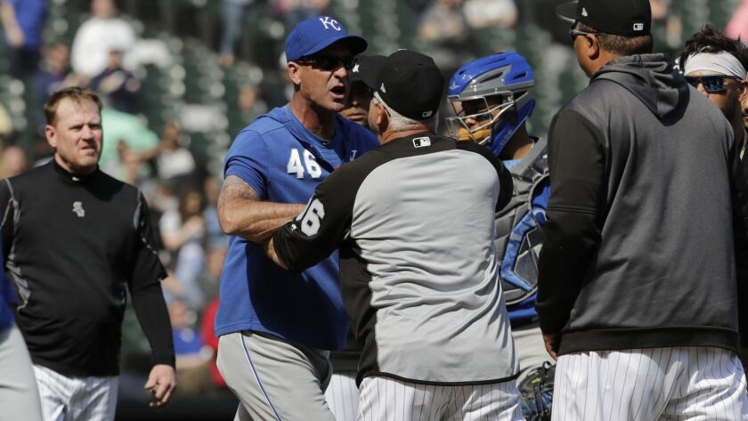 Kansas City Royals bench coach Dale Sveum (46) and Chicago White Sox manager Rick Renteria shove each other as benches clear during a game on April 17.