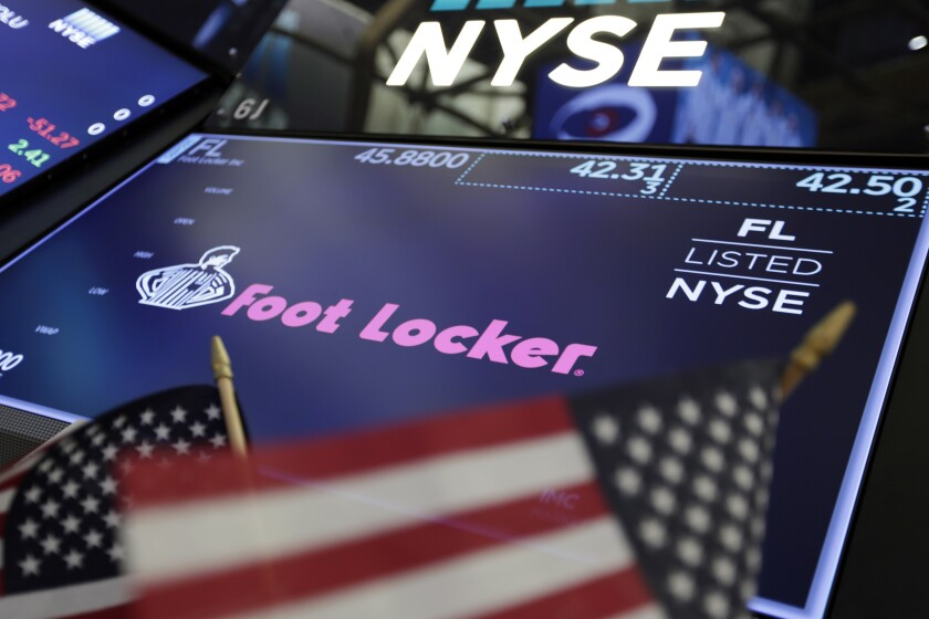 FILE - In this March 2, 2018 file photo, the logo for Foot Locker appears above a trading post on the floor of the New York Stock Exchange. Foot Locker's second-quarter comparable sales rose about 18%, helped by pent-up demand and the effect of the fiscal stimulus. Analysts polled by FactSet predict a 9.1% decline. The footwear company said Monday, Aug. 10, 2020, that its quarterly adjusted profit is anticipated in a range of 66 cents to 70 cents per share. (AP Photo/Richard Drew, File)