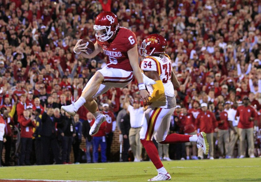 Oklahoma quarterback Baker Mayfield (6) leaps in for a touchdown against Iowa State during the first quarter of an NCAA college football game in Norman, Okla., on Saturday, Nov. 7, 2015. (AP Photo/Alonzo Adams)
