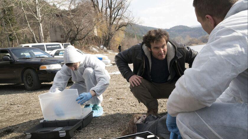 """Angel Bonanni, center, in Sony's thriller series """"Absentia."""""""