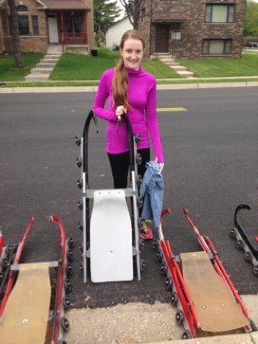 Chicago teen Joan Kemper shows the wheel-equipped luge sled she rode in preliminary tryouts for the U.S. Luge Junior Olympic team. She qualified for an invitation to compete for a spot Jan. 13-15 in Muskegon, Mich.