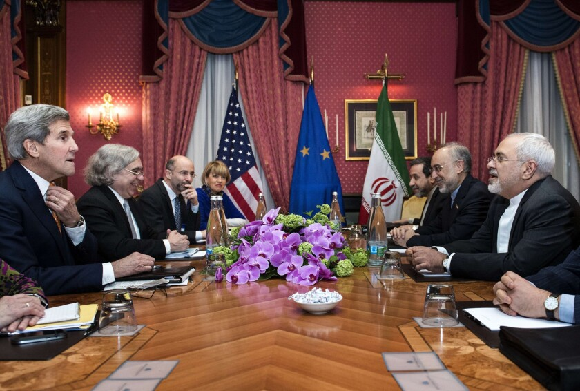 From left, U.S. Secretary of State John F. Kerry and Secretary of Energy Ernest Moniz face, from right, Iranian Foreign Minister Javad Zarif and Ali Akbar Salehi, head of the Iranian Atomic Energy Organization, at a hotel in Lausanne, Switzerland.