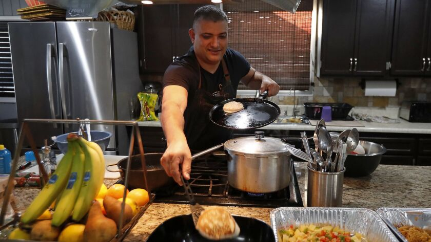 Steve Rivera, 43, a Transportation Security Administration agent, makes pancakes at his home in Gard