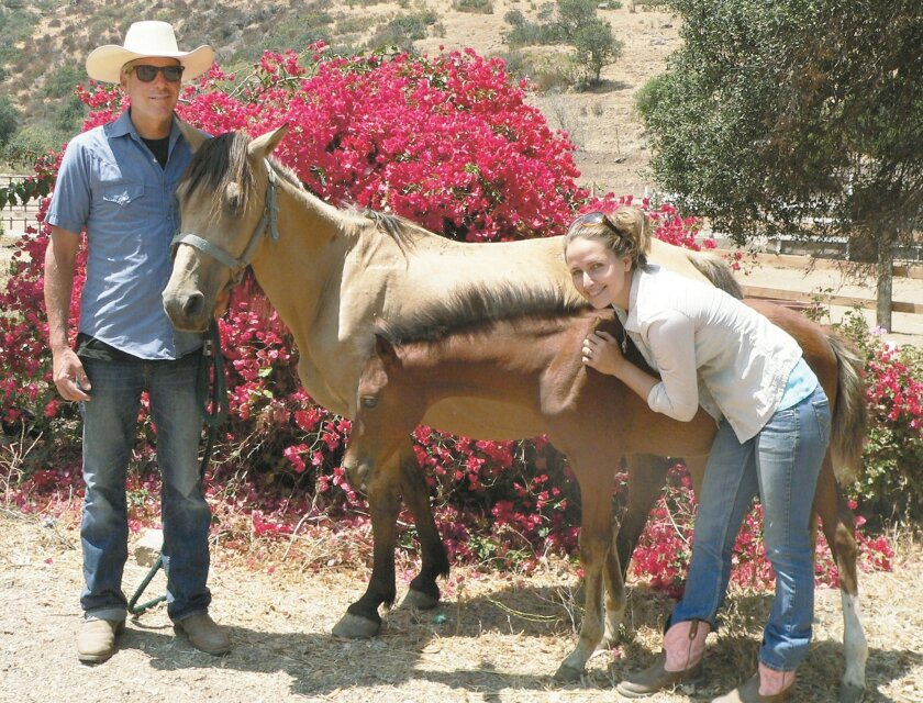 Randy and Krystal Redmon, founders of All the Pretty Horses of Baja Rescue and Rides, with Phoenix, a recent rescue, and her foal Milagro.