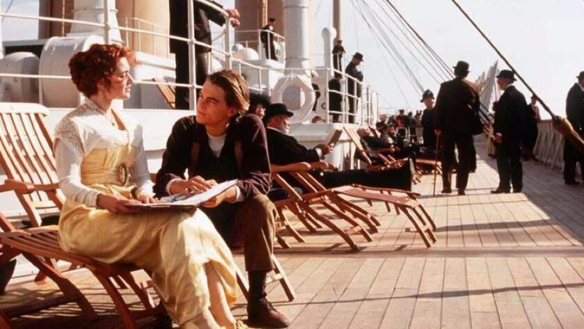 "Jack Dawson, played by Leonardo DiCaprio, and Rose DeWitt Bukater, played by Kate Winslet, portray passengers aboard the ill-fated Titanic in this scene from the movie ""Titanic."" (PARAMOUNT PICTURES/20TH CENTURY)"