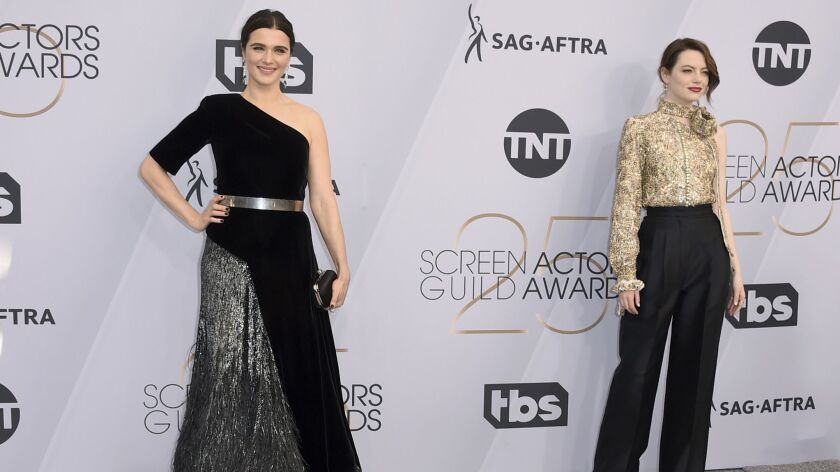 Rachel Weisz, left, and Emma Stone arrive at the 25th Screen Actors Guild Awards at the Shrine Auditorium in Los Angeles.