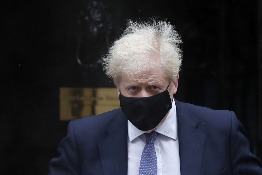 """Britain's Prime Minister Boris Johnson leaves Downing Street to attend the weekly session of Prime Ministers Questions at Parliament in London, Wednesday, Oct. 21, 2020. The European Union is taking a defiant tone as the standoff over resuming post-Brexit trade negotiations with the United Kingdom continues. The bloc told London Wednesday that """"you cannot have your cake and eat it too."""" (AP Photo/Frank Augstein)"""
