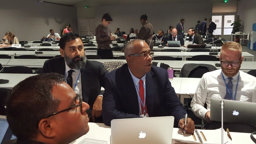 Hugh Sealy (center), a climate change consultant for the United Nations helped negotiate last year's Paris Agreement, and is the lead negotiator for small island countries at the 22nd Conference of the Parties to the U.N. Framework Convention on Climate Change.