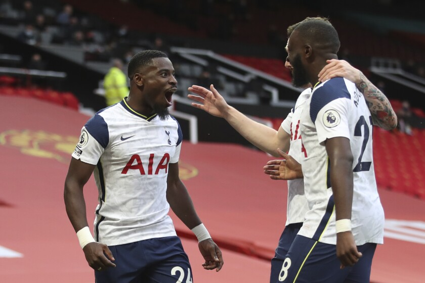 Tottenham's Serge Aurier, left, celebrates after scoring his side's fifth goal during the English Premier League soccer match between Manchester United and Tottenham Hotspur at Old Trafford in Manchester, England, Sunday, Oct. 4, 2020. (Carl Recine/Pool via AP)