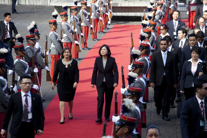 Taiwan's President Tsai Ing-wen, center right, arrives at the Supreme Court in Guatemala City, Guatamala, on Jan. 12, 2017 during a state visit.