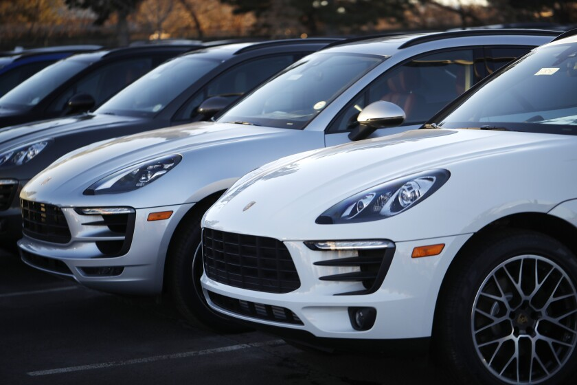 Macan sport utility vehicles at a Porsche dealership in Littleton, Colo.