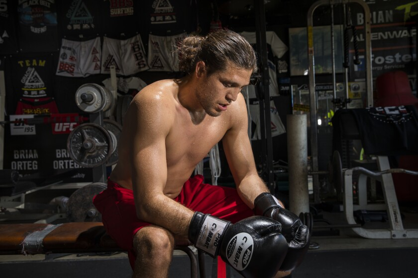 """Brian """"T-City"""" Ortega, a UFC featherweight fighter, pauses during his workout."""