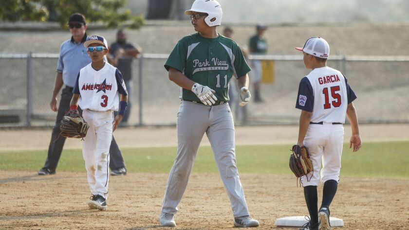 Park View's Michael Rodriguez stands at second base between Chula Vista American's Diego Garcia (right) and Noah Solano last month.