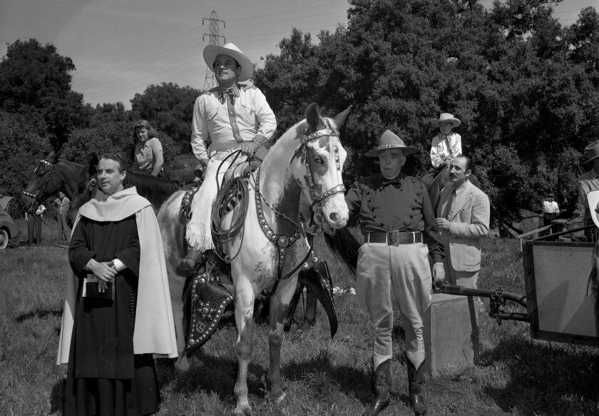 April 6, 1941: Actor Leo Carrillo, on horseback. and Irvin S. Cobb at Palm Sunday service for El Cam